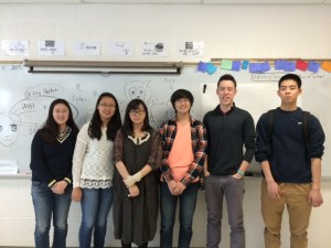 A few regular Mandarin Club members with their advisor Mr. Yeung outlining a new mural for Chinese New Year.