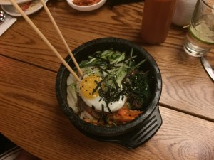 The bibimbap, a traditional Korean dish served with beautiful presentation and equally commendable taste.